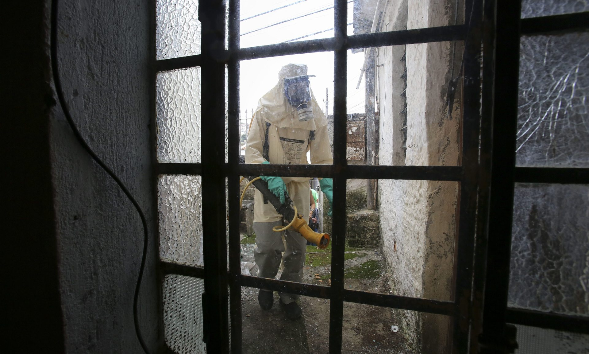 The Brazilian government fumigates houses to prevent the possible spread of the mosquito that transmits the Zika virus. Photograph: Sebastiao Moreira/EPA