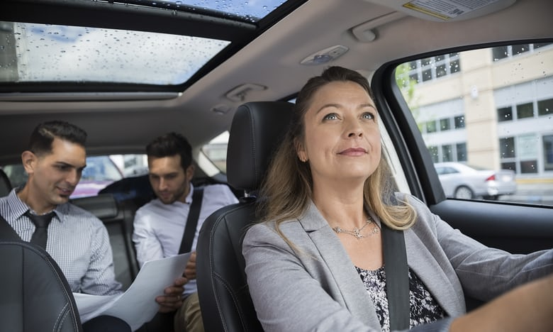 Business people carpooling. Photograph: Getty Images/Hero Images